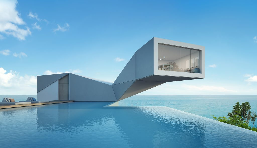 Futuristic rectangular home with raised living area, swimming pool in foreground and sea and sky in background