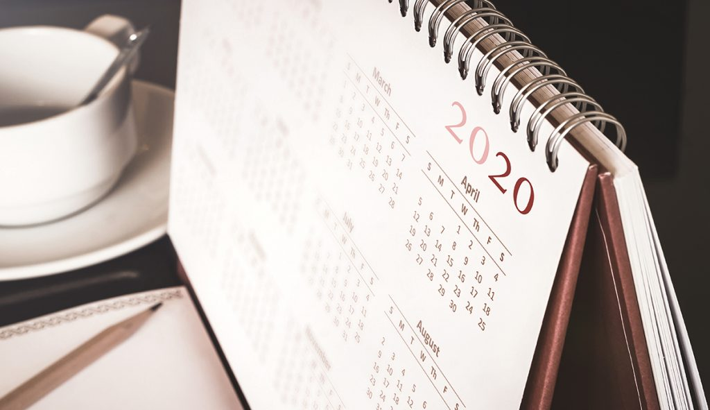 Calendar on a desk with dates for potential payment holiday options