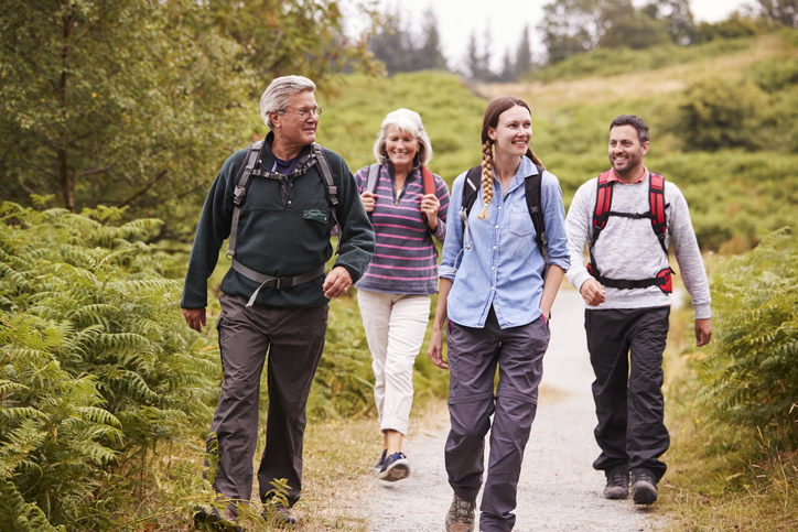 Family on a country walk discussing Estate planning and making plans to protect the family's financial future