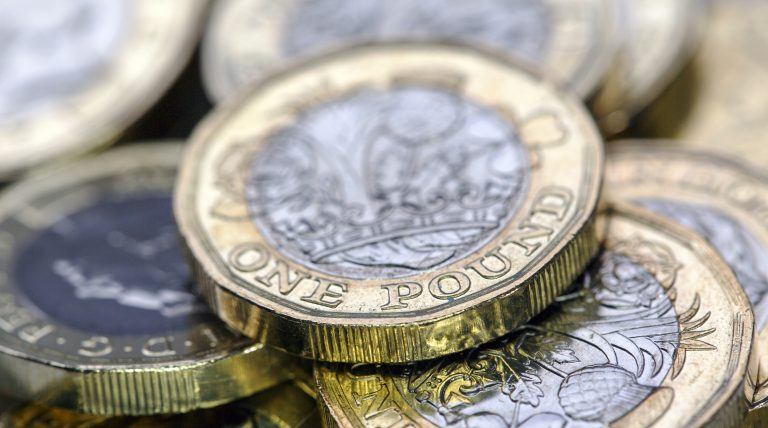 Stack of pound coins ready to withdrawn for a pension