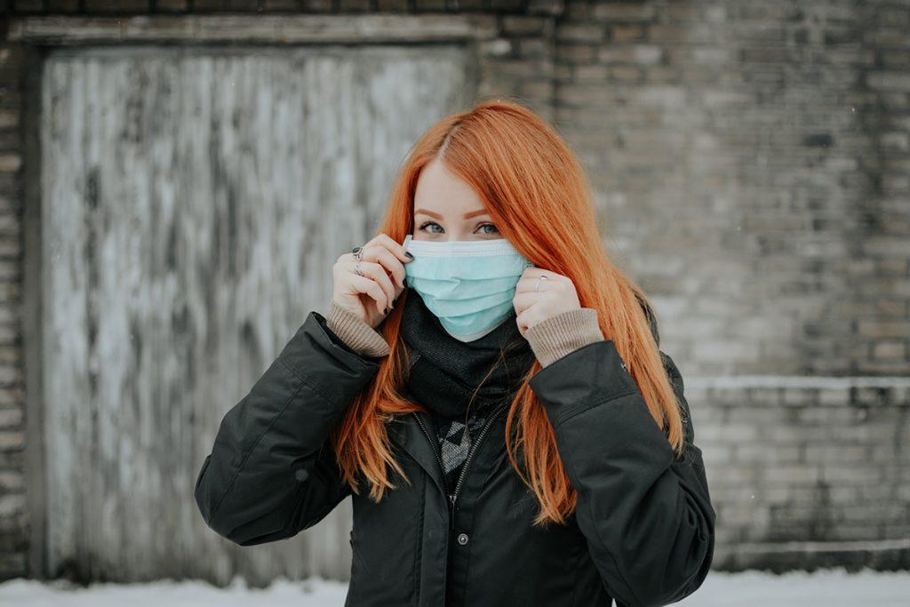Young women wearing a face mask, the intergenerational impact of coronavirus