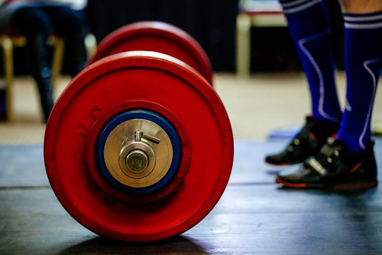 Barbell for deadlift and foot athlete powerlifter, getting financially fit for a new way of life