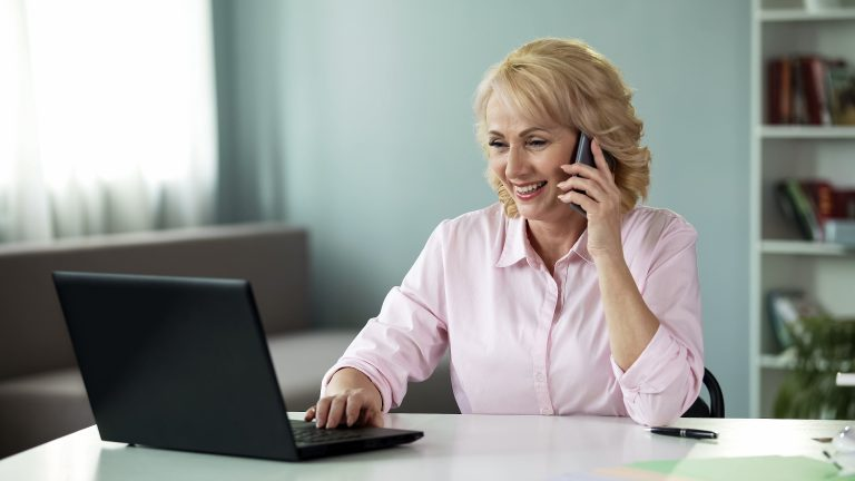 Mortgage adviser on the phone to a client supporting them in 2021