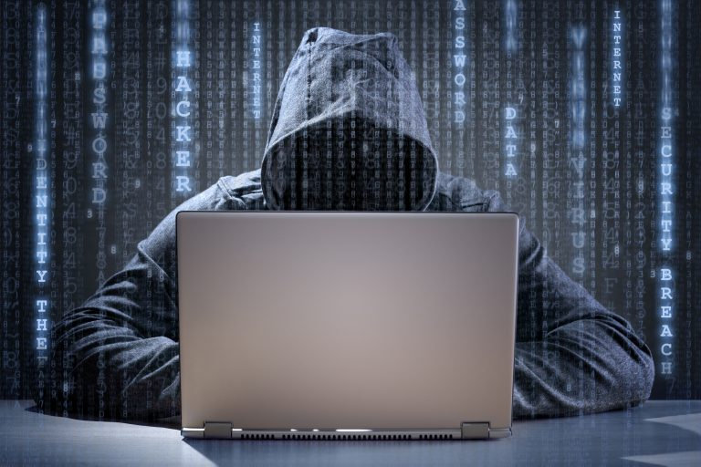 "Computer hacker stealing data from a laptop, ""It won't happen to me"" - think again"