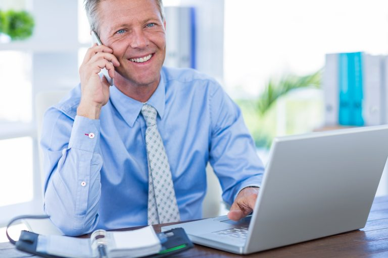 Financial adviser on the phone to a client, making time to get advice