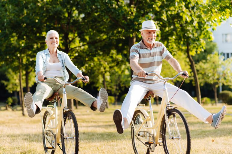 Retirement couple on their bikes having a day out In the countryside
