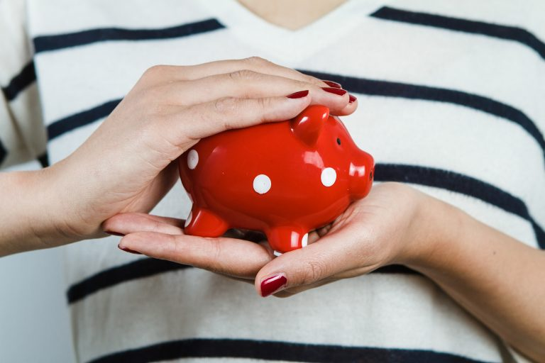 : Lady holding a piggy bank, saving for private education