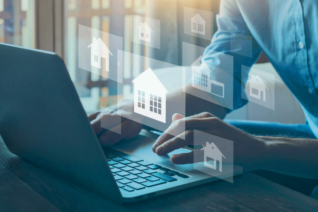 Man on laptop with housing visuals overlaid, looking for mortgage options